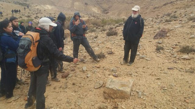 Prof. Chaim Ben David, historian of the Kinneret Academic College near one of the milestones that Ziv Sherzer found earlier (Photo credit: Midreshet Ben Gurion, Sde Boker)